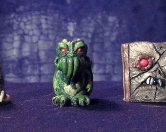 H.P. Lovecraft UV Glow Miniatures (Set of 1)