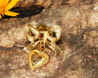 Gold Toned Bow & Heart Pin with Simulated Garnet Rhinestone