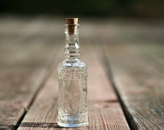 Clear glass bottle 5 inches tall bottle cork fill with for Colored glass bottles with corks