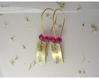 Bowties are cool Doctor Who earrings. Hand stamped and texturized  brass and Swarovski fuchsia bead