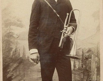 Man in uniform with trumpet antique photo