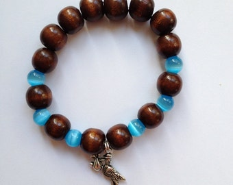 "CLEARANCE *** Nice ""Baby boy"" wood beads bracelet with blue cat's eye and a stork and baby charm"