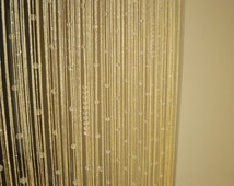 Golden-tone beaded curtain
