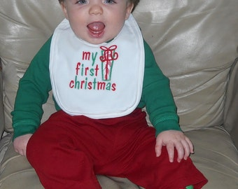 Baby's First Christmas features a present. Available on a body suit, shirt, bib or burp cloth.