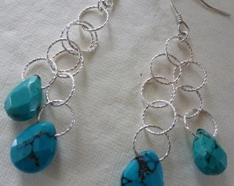 Argentium silver French earwires and two tiers of diamond-cut silver chain display faceted turquoise brios   Silver Sky Earrings