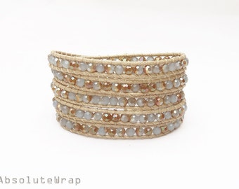 Gray gold crystal wrap bracelet on soft beige polyester cord