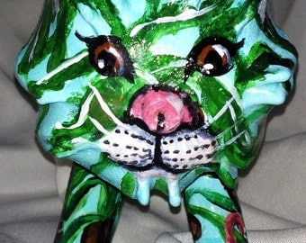 Tropical Tiger is a tiger sculpture using natural gourd transformed into a gourd art collectible