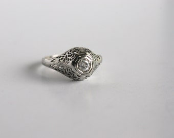 Early 1900's 14K white gold filigree detailed diamond ring
