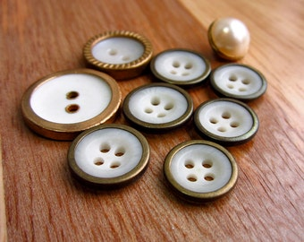 Set of Nine Assorted Metal Rimmed Round White Buttons