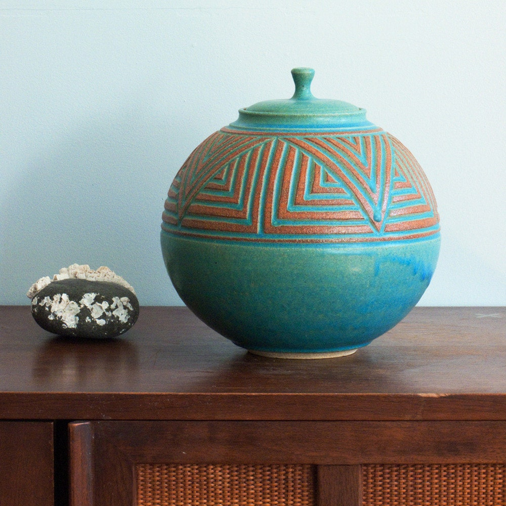 Round lidded carved jar in turquoise glaze hand thrown