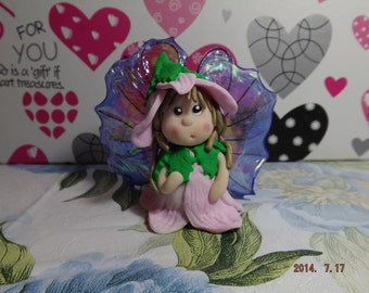 Baby fairy in fimo with ali in fantasy film