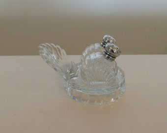 Salt and Pepper Shakers Glass with Silver Lids on a Serving Tray