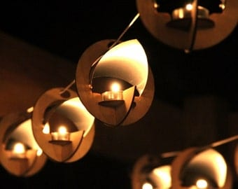 Skyboats: Hanging Lantern String Lights.  Tealight Candle Lit kits with tin roof reflectors. Outdoor Party Lights!