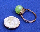 Ring Hammered Bronze colored Wire Wrapped with Faceted Green Glass Bead Size 6