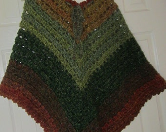 Adult poncho in greens and brownsmade with Homespun yarn