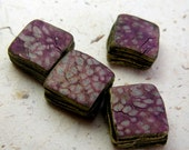 Spotted square metallic strata beads in polymer with plum, pale blue and pink accents