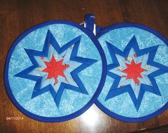 Blue folded star pot holders.