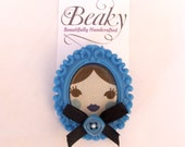 Doll face cameo brooch - blue and black