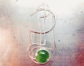 whiplash sterling silver and jade pendant