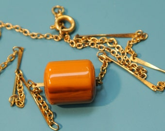 Necklace with vintage 1940s brass chain and one tubeformed flamy swirled goldbrown genuine tested vintage 1940s bakelite plastic bead