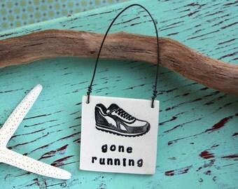 Ceramic Gone Running Sign