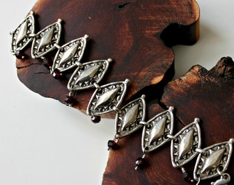 African inspired silver garnet wide shield bracelet