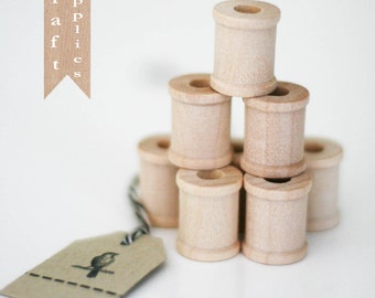 12 Unfinished wooden spools 3/4""