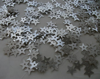 New item -- 7g of 7 mm Star Sequins in Matte Gold Silver Color (approximately 1100 ct.)