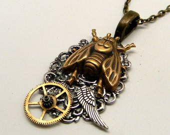 Steampunk jewelry . Steampunk bee necklace with angel wing and gears.