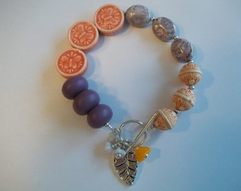 Peach and Lilac Hand Beaded Bracelet witgh Charms