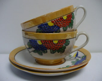 Pair of Lusterware Cups and Saucers