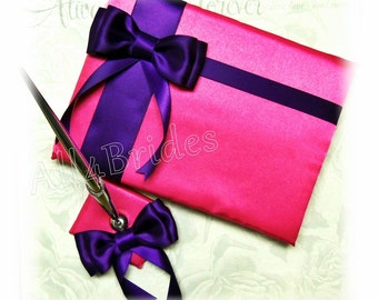 Regency purple and fuchsia wedding guest book and pen set.