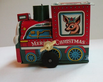 Children's toy vintage Christmas train, Yuletide wind-up locomotive, kids boys girls retro holiday decoration decor gift kitsch railroad