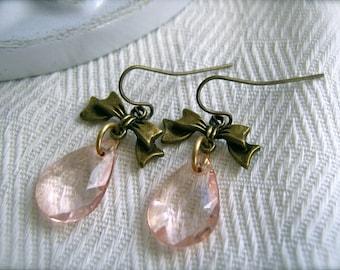 Earrings Peach Crystal Drop Earrings. Bow Charm Earrings. Peach Crystal Earrings. Rose Pink Dangle Earrings. Brass Bow Earrings.