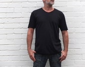 Men's black t-shirt with raw edges throughout.