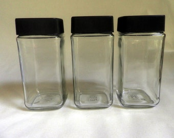 square Clear Glass Jars with black screw-on lids, stackable, lot of 3