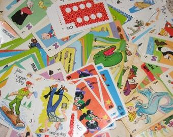 A Dozen Assorted Vintage Children's Playing Cards