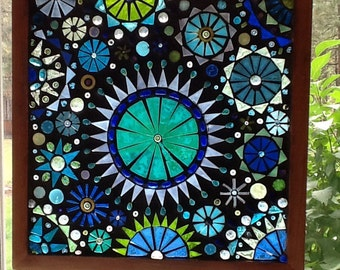 Beautiful glass on glass mosaic window panel in shades of blue and green