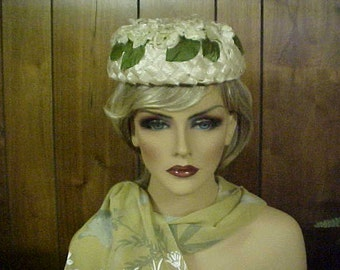 SALE.  Natural straw pill box hat with flowers and leaves on top- union made- fits 23 inches