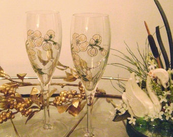Unique Floral enameled toasting flutes w/ delicate gold accents..Gardenia type flowers with rich deep green leaves, gorgeous