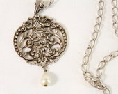 Vintage Avon ornate silver toned pendant with faux drop pearl necklace