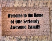Welcome to the Home of One Seriously Awesome Family™ funny Novelty doormat