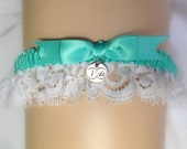 "Aqua Bridal garter in satin with Alecon style lace & a satin bow topped with an ""I DO"" charm"
