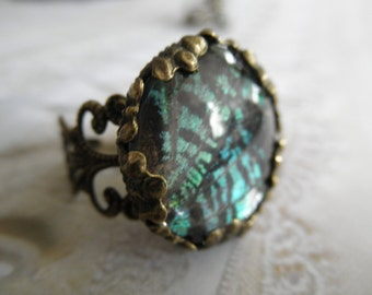 Spiritual, Colorful Sunset Moth Wing Beneath Glass-Victorian Filigree Bronze Glass Ring-Gifts Under 25-Symbolizes Noble Spirit