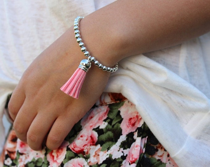Pink and Silver Beaded Tassel Bracelet.