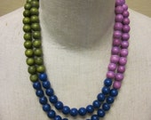 Necklace, 2-strand, round wood beads, color-blocked, dk. blue/olive green/orchid, mid-length, barrel clasp