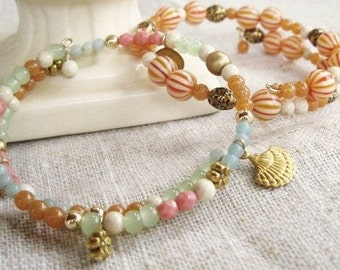Two beaded wrap bracelets with chalcedony, aventurine, riverstone, czech glass, gold fill balls, brass charms