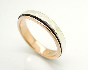 Rose gold ring with a hammered silver spinner