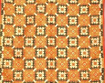 Retro, tribal inspired acetate scarf by Ponte Tresa. Orange, red, yellow, black, geometric, bold.