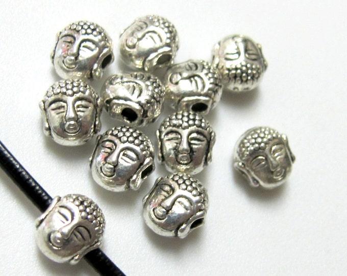 10 Beads - Dual sided Tibetan Buddha bead - BD386